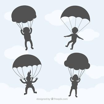 Paragliders parachutespringen in de hemel vector schaduwen