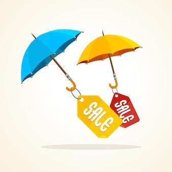 Paraplu's met verkoopstickers, tags en labels. winter, herfst, zomer.