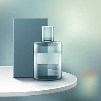 Parfumflesje met doos, geïsoleerd op de tafel