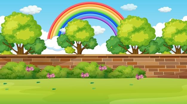 Parklandschapsscène met regenboog in de lucht