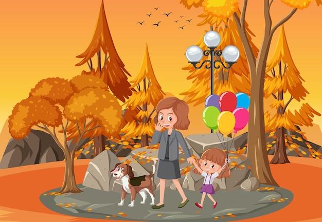 Parkscène in zonsondergangtijd met moeder en dochter