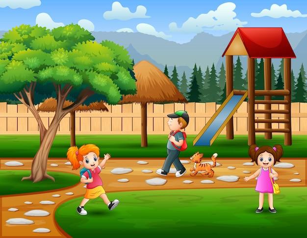 Parkscène met de illustratie van de kinderen
