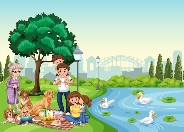 Parkscène met gelukkige familie die van picknick geniet