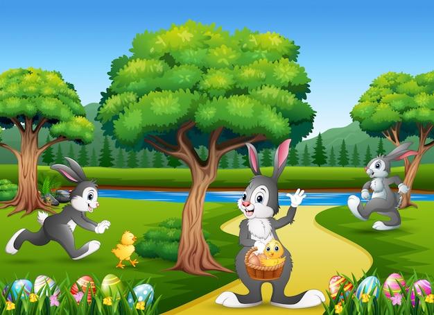 Pasen-achtergrond met konijntjes en babykuiken op de aard