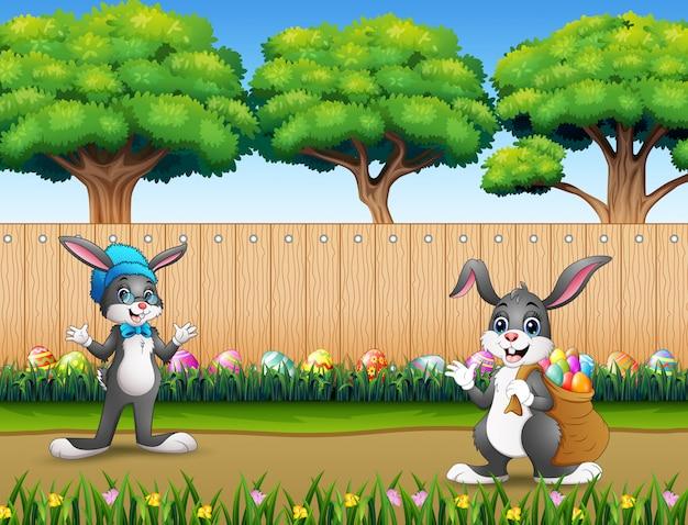 Pasen-achtergrond met konijntjes op de aard