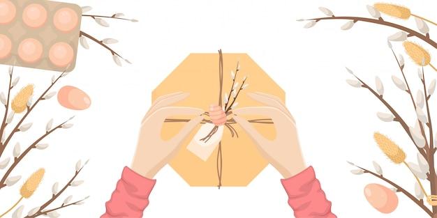 Pasen-illustratie met paaseieren en wilgentakken. de handen van het meisje openen het geschenk.