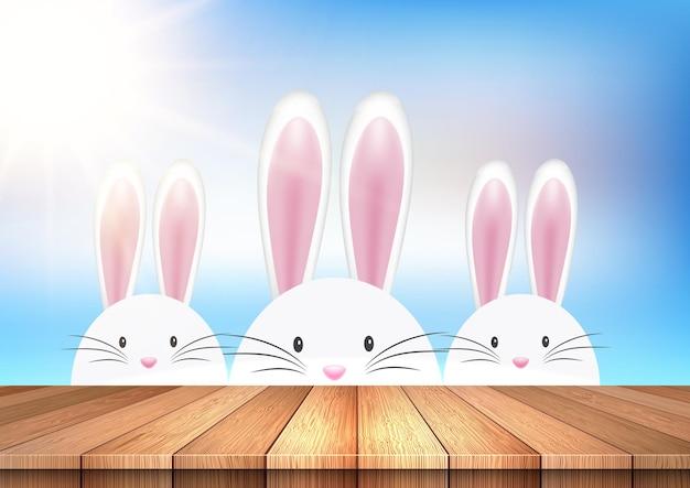 Pasen-illustratie met schattige konijntjes die over een houten lijst kijken