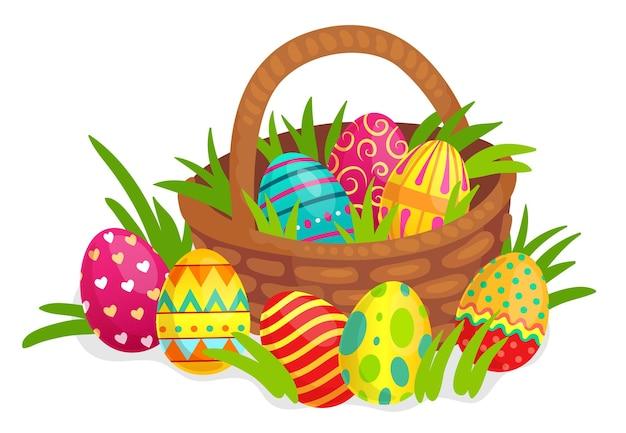 Pasen versierde eieren in rieten mand. kleurrijke eieren met harten, lijnen, stippen en krullen decoratie voor vakantieviering. helder geschilderd symbool voor pasen met gras vectorillustratie