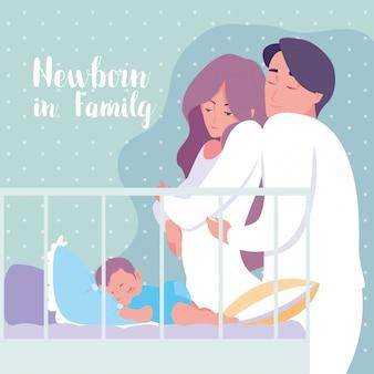 Pasgeboren in familie met ouders en babyjongenslaap in voederbak