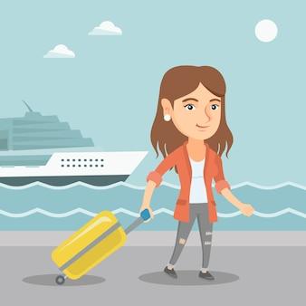 Passagier gaat naar de cruiseschip met een koffer