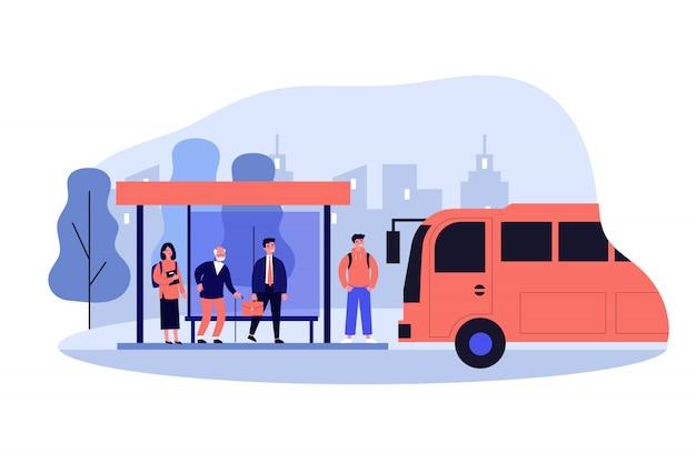 Passagiers staan bij de bushalte