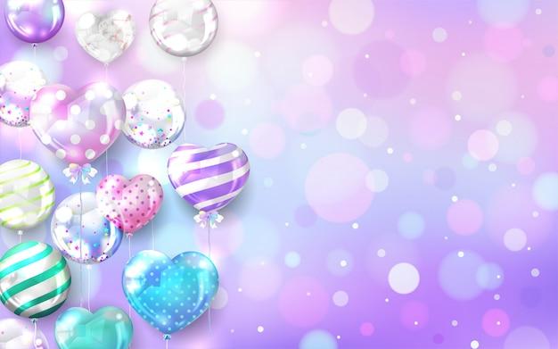 Pastelkleurballons op bokehachtergrond met exemplaarruimte