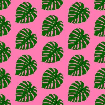 Patroon groene exotische bladeren monstera op een roze achtergrond