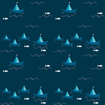 Patroon met blauwe papieren schepen en de zee met vissen