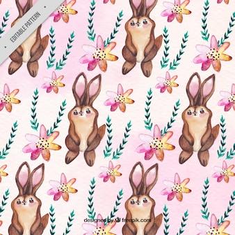 Patroon van konijntjes met bloemenornamenten