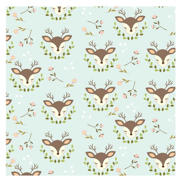Patroon van schattige herten en bloemen op blauwe achtergrond