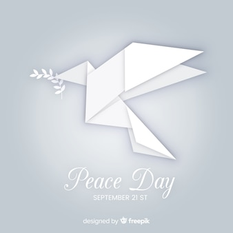 Peace day concept met origami dover