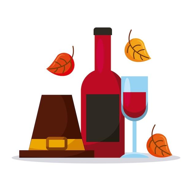 Pelgrimshoed met wijnflesglas en herfstbladeren
