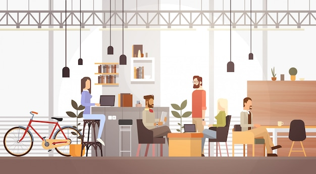 People in creative office co-werkcentrum university campus modern workplace interior