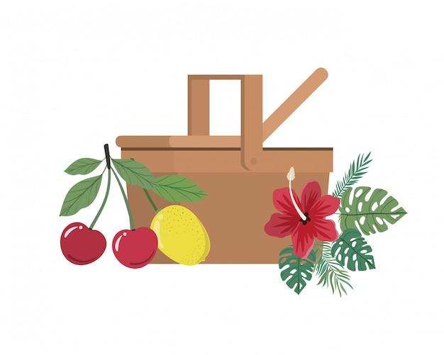 Picknickmand met tropisch fruit op wit