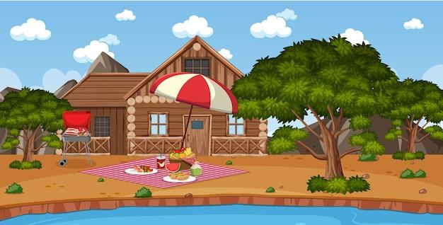 Picknicktafereel met eten op tafel en bbq-grill in de tuin