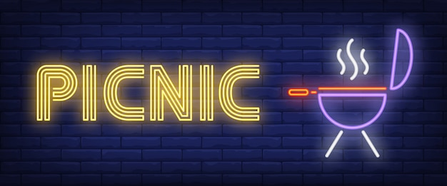 Picnic-neontekst met barbecuegrill
