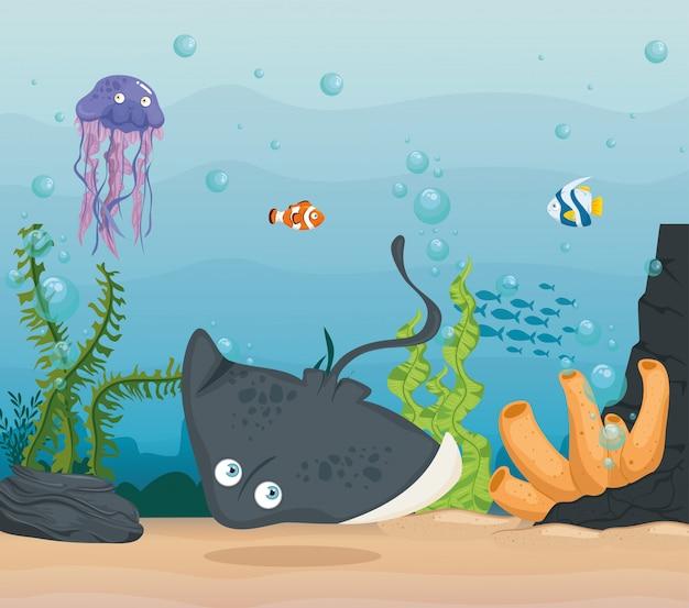Pijlstaartrog en zeedieren in de oceaan, bewoners van de zeewereld, schattige onderwaterwezens, onderzeese fauna
