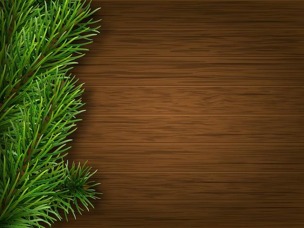 Pijnboomtak op oude bruine houten achtergrond