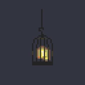 Pixel art gloeiende vogel in de kooi.