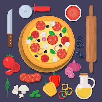 Pizza met bakselingrediënten en deegroller