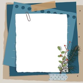 Plakboekcompositie met notitiespapier, banden, bloemenelementen en fotolijst.