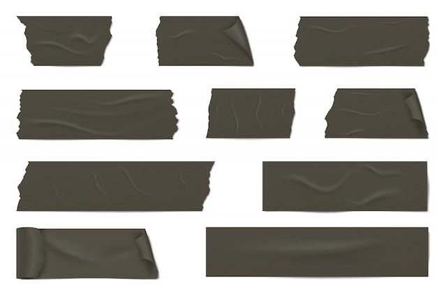 Plakjes van een zwarte plakband met schaduw en rimpels.