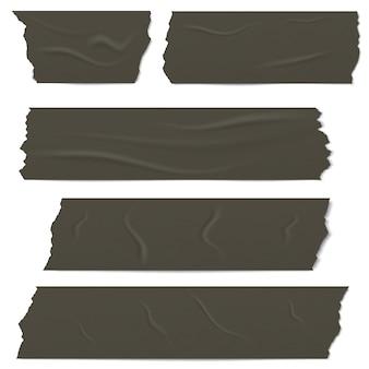 Plakjes zwarte plakband met schaduw en rimpels.