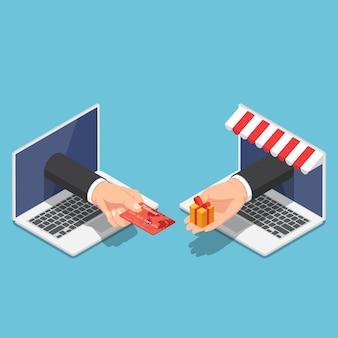 Platte 3d isometrische zakenmanhand komt uit een laptopmonitor en gebruikt een creditcard om online te winkelen. online winkel- en betalingsconcept.