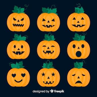 Platte halloween-pompoeninzameling op zwarte achtergrond