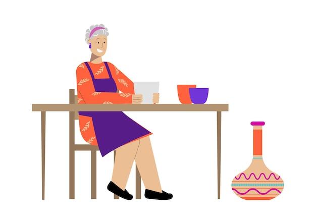 Platte hobbycompositie met gelukkige oudere vrouw die aardewerk doet