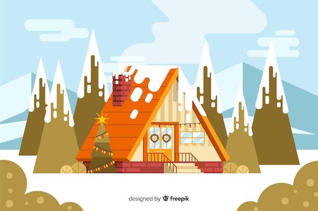 Platte kerst achtergrond met huis omgeven door bomen