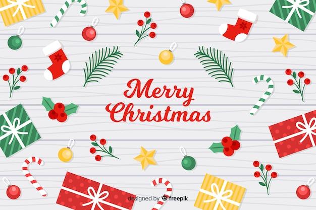 Platte kerst achtergrond met kerst elementen