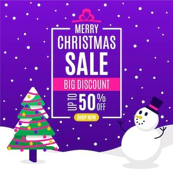 Platte kerst verkoop en boom met sneeuwpop Gratis Vector