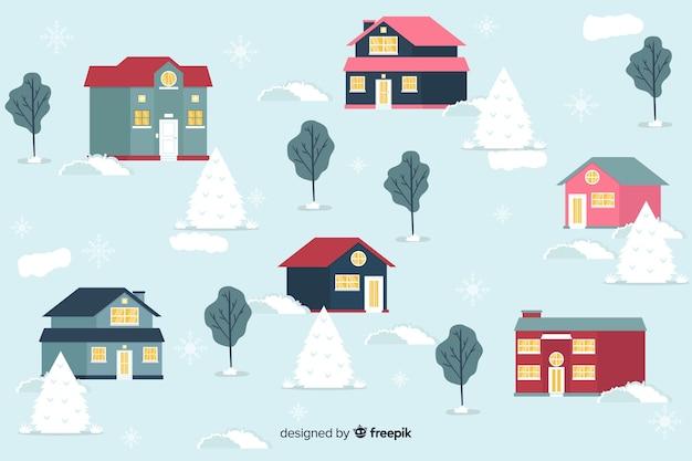 Platte kerststad met besneeuwde achtergrond