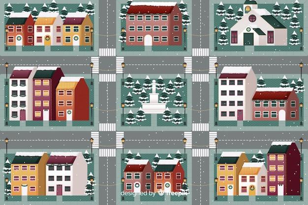 Platte kerststad met huizen en straten
