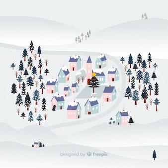Platte kerststad met sneeuw