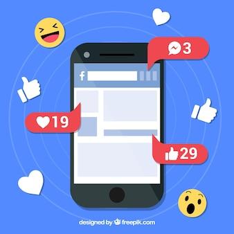 Platte mobiel met facebookmeldingen en emoji's