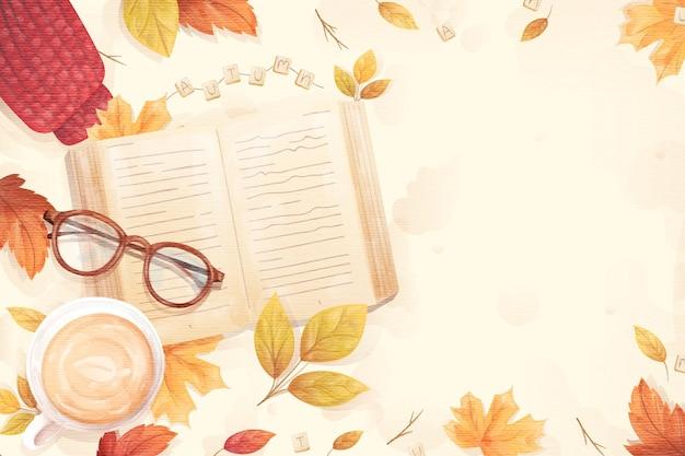 Platte ontwerp herfst achtergrond met boek en glazen