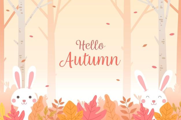 Platte ontwerp herfstbladeren achtergrond met konijntjes