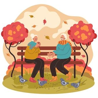 Platte ontwerp herfstmensen die vogels voeren