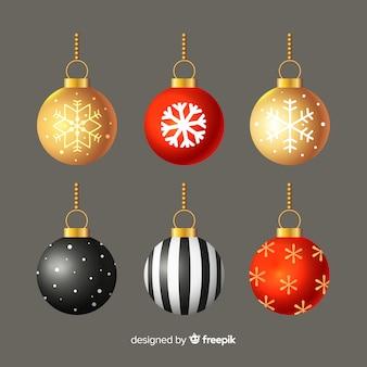 Platte ontwerp kerstballen op grijze achtergrond