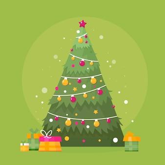 Platte ontwerp kerstboom met cadeautjes Gratis Vector