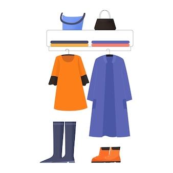 Platte ontwerp kledingwinkel display illustratie met jas kleding schoenen tassen voor dames