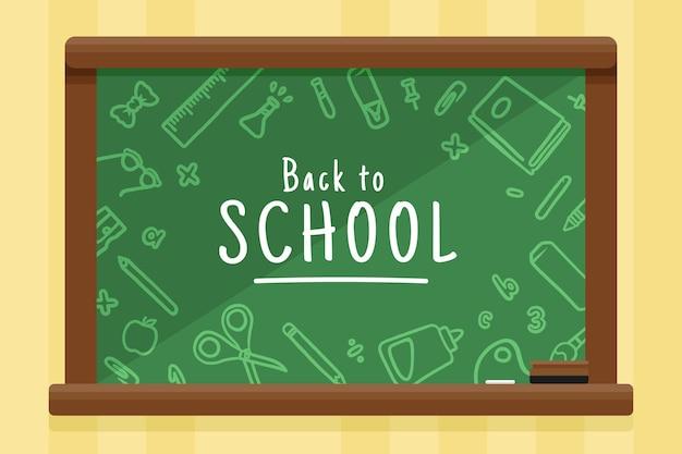 Platte ontwerp terug naar school achtergrond met schoolbord